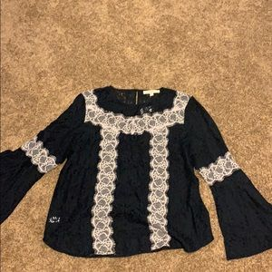 Lace blouse with trumpet sleeves